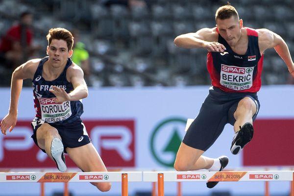 Victor Coroller à gauche et le Serbe Emir Bekric à la lutte pendant le 400 mètres haie à Berlin