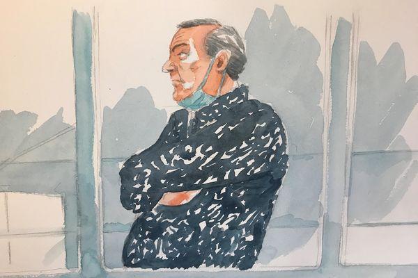 Philippe Gillet, les cheveux grisonnants, dans le box des accusés, aux assises de la Marne, le 6 avril 2021.