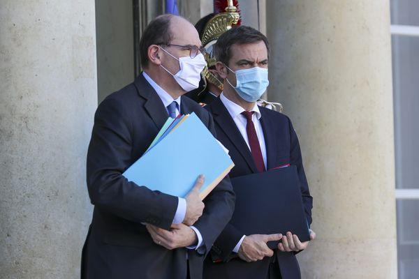 Le Premier ministre Jean Castex et le ministre de la Santé Olivier Véran à la sortie du conseil des ministres le mercredi 18 novembre.