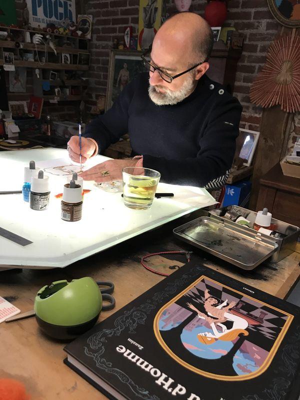 Zanzim à sa table de dessin