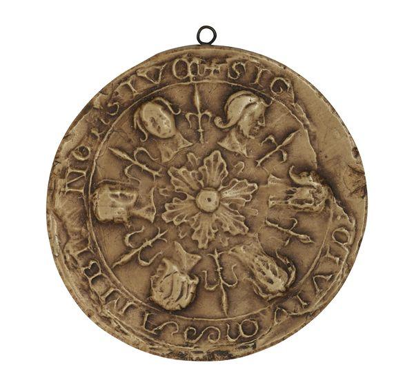 Sceau de la ville d'Amiens en 1228 représentant six têtes et six fleurs de lys autour d'une rose centrale