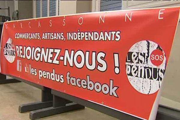 """Pancarte du mouvement des """"pendus"""" à Carcassonne, qui dénoncent le RSI."""