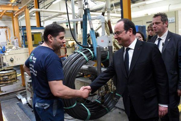 François Hollande chez Lisi Automotive à Melisey (Haute-Saône)