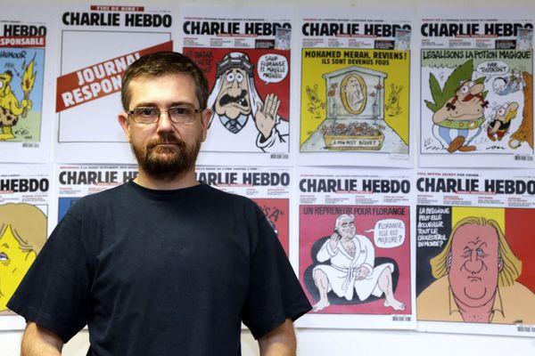 Charb, dans les locaux de Charlie Hebdo, le 27 décembre 2012.