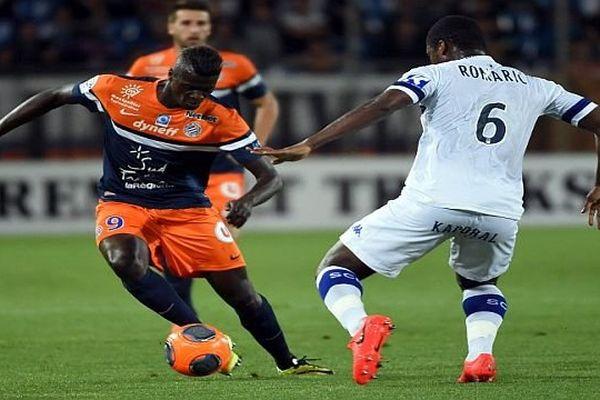 Montpellier - M'baye Niang lutte avec un Bastiais - 10 mai 2014.