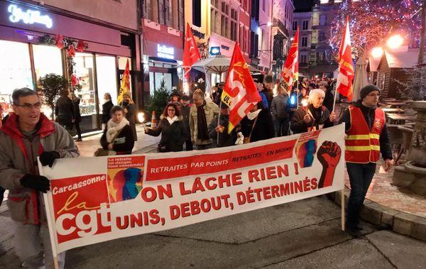 Retraite aux flambeaux dans le centre de Carcassonne contre le projet de réforme des retraites, 30 décembre 2019