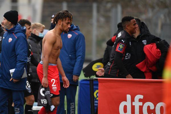 Le défenseur Sacha Boey après le coup-sifflé final du match DFCO-Nîmes Olympique (0-2)