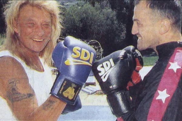 Johnny en plein entraînement avec son coach sportif Laurent Petit à Saint-Tropez.