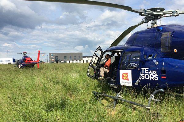 Dans tout le Bessin, les hélicoptères ont surpris la population dimanche dès la fin d'après-midi. On les retrouve ici à St Contest , près de Caen, derrière les locaux de la CCI.
