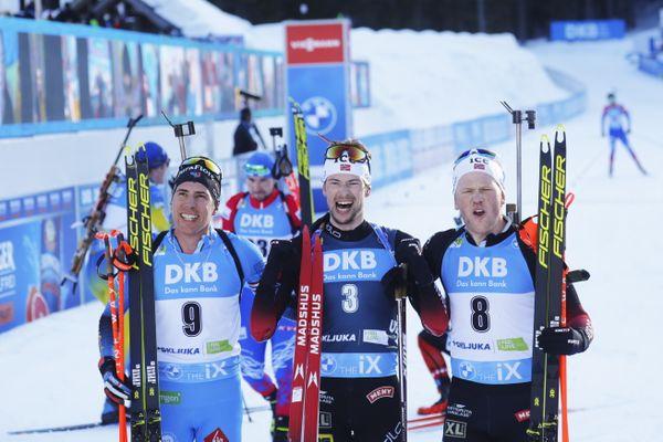 Le podium de la mass-start des Mondiaux de biathlon à Pokjuka en Slovénie. Quentin Fillon-Maillet (à gauche) est arrivé troisième