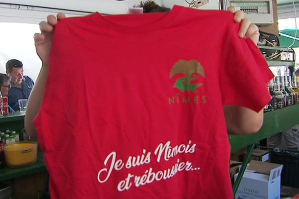 Nîmes - Pour les vrais, les purs, les réboussiers, la feria c'est en rouge et vert, depuis toujours. Les couleurs des clubs de foot, de handball et de rugby - 2019.