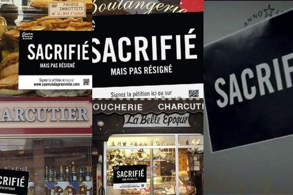 """Des affichettes """"Sacrifié mais pas résigné"""" sont apposés sur des vitrines de commerçants ou artisans."""