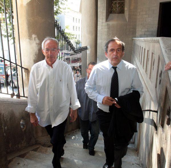 Marc Riolacci, au côté de Michel Platini, lors des obsèques d'Antoine Redin, à Bastia, en août 2012.