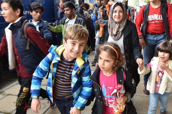 Des migrants à Schoenefeld, en Allemagne, le 18 septembre 2015