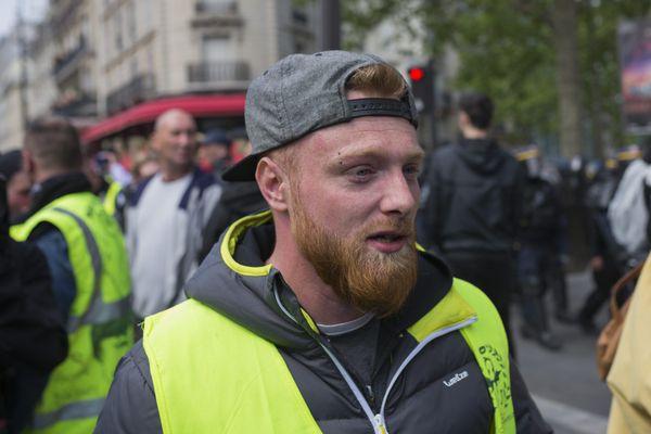 Maxime Nicolle lors d'une manifestation à Paris le 1er mai 2019