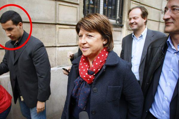 Alexandre Benalla (à gauche), accompagnant Martine Aubry le 17 octobre 2011 rue de Solférino à Paris.