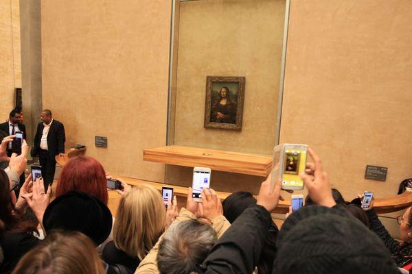"""""""La Joconde"""", peinte par Léonard de Vinci au début du 16e siècle, au Louvre (illustration)."""