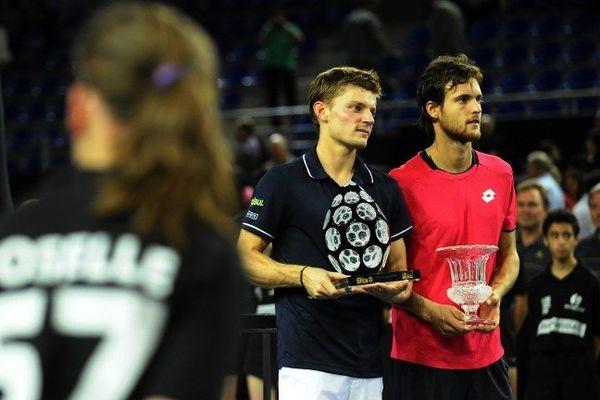 Le belge David Goffin remporte pour la première fois le Moselle Open à Metz (Moselle). Il a battu dimanche 21 septembre 2014 le portuguais Joao Sousa sur le score de 6/4 6/3.