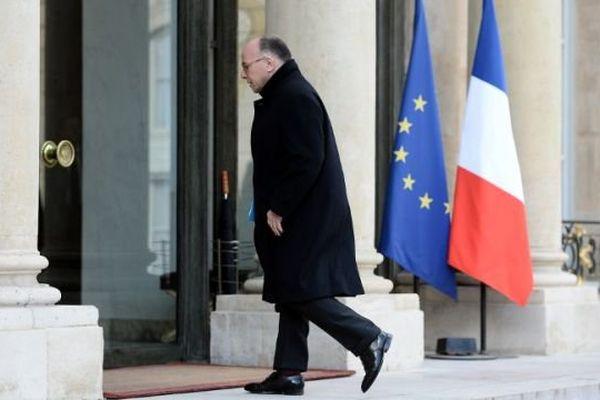 Bernard Cazeneuve arrivant à l'Elysée après les attaques sur Bruxelles, ce mardi 22 mars 2016.