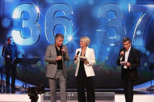 Le comédien Franck Dubosc, parrain de cette 26 édition du Téléthon, en plateau avec Sophie Davant et Nagui.