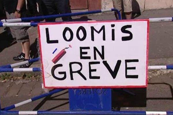 Une pancarte installée devant le site de l'entreprise Loomis à Rilleux-la-Pape le 1er août 2013