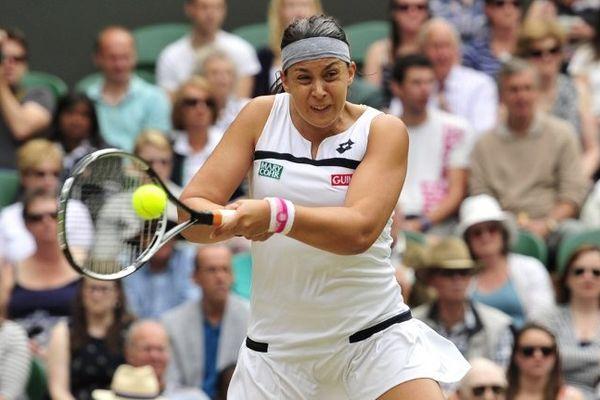 Marion Bartoli victorieuse en demi-finale de Wimbledon, le 4 juillet 2013, de la belge Kirsten Flipkens 6/1 6/2.