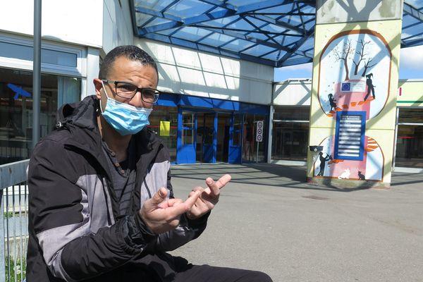 """Tête de liste RN pour les régionales dans le Territoire de Belfort, Kamel Agag-Boudjahlat,  photographié dans son quartier de la Petite-Hollande à Montbéliard, affirme que sa candidature était une imposture et qu'il voulait ' infiltrer le RN """"."""