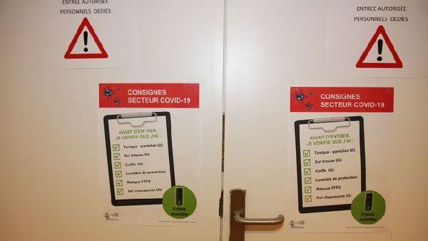 Consignes de sécurités à l'entrée du secteur Covid de l'Institut de Cancérologie  de Lorraine