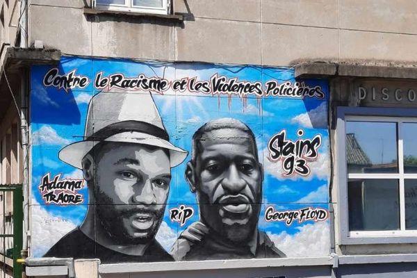 Les visages de George Floyd et Adama Traoré peints sur une fresque à Stains.