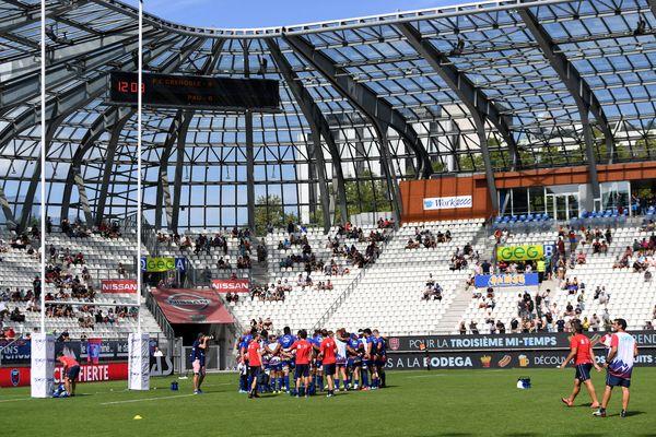 Illustration. Les joueurs du FC Grenoble Rugby au stade des Alpes en 2018.