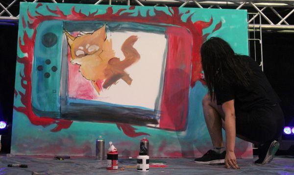 Peinture live de Pikanoa sur la scène de l'Orléans Game Show