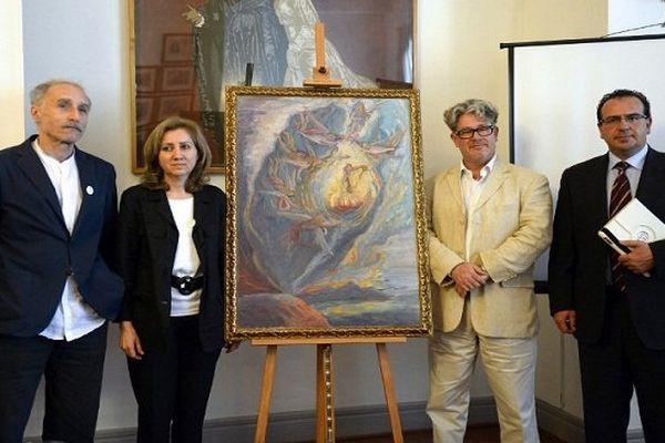 Tomeu L'Amo, à gauche sur la photo, avait achetée cette peinture à l'huile dans un magasin d'antiquités de Gérone.