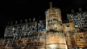 """FRANCE, Le Mans : Digital images are projected on the cathedral """"Saint Julien"""" on July 6, 2014, in Le Mans, western France. Called The """"Night of Fancies"""" and annually in July or August, this show created by SKERTZO, 9 years ago, attracts 250,000 tourists in the city. Le Mans hopes to draw attention to its old town and its Gallo-Roman surrounding wall. / © AFP PHOTO / JEAN-FRANCOIS MONIER"""