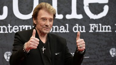 Johnny Hallyday au festival international du film policier de Beaune en avril 2014 / © JEAN-PHILIPPE KSIAZEK / AFP