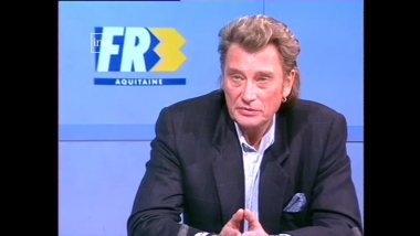 Johnny Hallyday sur le plateau du journal de France 3 Aquitaine / © INA/ France 3 Aquitaine