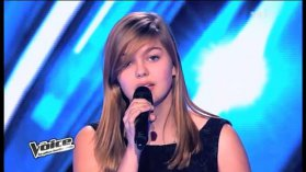 Louane, 16 ans, a ému les quatre jurés de l'émission The Voice avec sa reprise de William Sheller. / © TF1